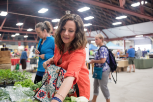 Shannon Sponagle selecting produce